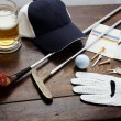 Golf equipment on a wooden table - Stock Photo