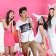 Asian young boy and girls singing karaoke — Stock Photo