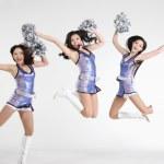 Portrait of jumping cheerleaders — Stock Photo