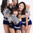 Four cheerleader taking a picture of themselves — Stock Photo