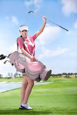 Asian woman play golf — Stock Photo