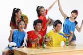 Asian sports fans rooting for their favorite team — Stock Photo