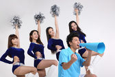 Portrait of cheerleaders and a man yelling through megaphone — Fotografia Stock
