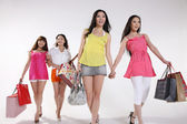 Young asian women go shopping — Stockfoto