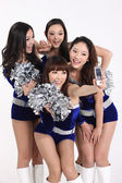 Four cheerleader taking a picture of themselves — Стоковое фото