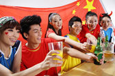 Asian sports fans posing — Stock Photo