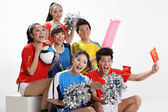 Asian sports fans rooting — Stock Photo