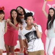 Asian boy singing karaoke with girls — Stock Photo #19323147