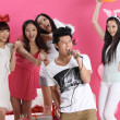 Asian boy singing karaoke with girls — Stock Photo