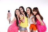 Happy asian teenagers taking their own picture — Stock Photo