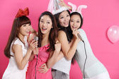 Four asian girls singing karaoke — Stock Photo