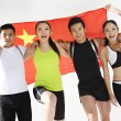 Group of young athletes holding China flag  — Stock Photo