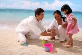 Family with beach — Stock Photo