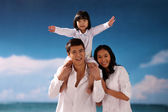 Family with beach — Stock Photo