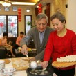 Stock Photo: Chinese mature couple making chinese dumpling on New year's Eve