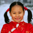 One chinese girl looking at camera smiling — Stock Photo