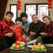 A shot of Chinese family reunion in the house — Stock Photo #34862935