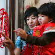 Chinese young mother playing with her daughter — Stock Photo