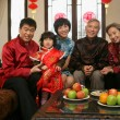 A shot of Chinese family reunion in the house — Stock Photo