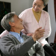 Chinese mature couple talking — Stock Photo
