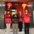 Stock Photo: Chinese family making wish with hands clasped