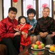A shot of Chinese family reunion in the house — Stock Photo #34868575
