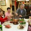 A shot of Chinese family at dinner table — Stock Photo #34869261