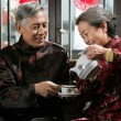 Chinese mature couple drinking tea — Stock Photo