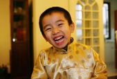 One chinese boy dressed in traditional clothing looking at the c — Stock Photo