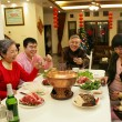 A shot of Chinese family at dinner table — Stock Photo #34870881