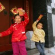 Two children(5-18 years) standing in front of chinese traditiona — Stok fotoğraf