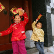 Two children(5-18 years) standing in front of chinese traditiona — 图库照片