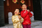 Two children(5-11 years) standing in front of chinese traditiona — Stock Photo