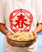 Chinese young woman holding a bowl of Chinese dumpling — Stock Photo
