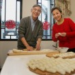 Chinese mature couple making chinese dumpling on New year's Eve — Foto de Stock