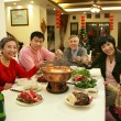 A shot of Chinese family at dinner table — Stock Photo
