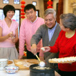 A shot of Chinese family reunion in the house — Stock Photo #34927463