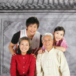 Old couple with young boy and girl — Stock Photo