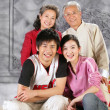 Old couple with young boy and girl — Stock Photo #35236071