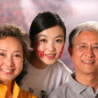Family in stadium and cheering — Stock Photo
