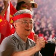 Stock Photo: An old man cheering in stadium