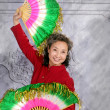 Oriental senior woman dancing with fan — Stock Photo