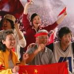 Crowd cheering in stadium — Stock Photo