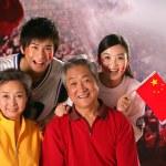 Family in stadium and cheering — Stock Photo