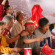 Crowd cheering in stadium — Stock Photo