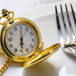 Dish,fork and pocket clock — Stock Photo #35777085