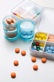Schedule box containing capsules and capsules — Stock Photo