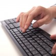 Fingers typing computer keyboard — Stock Photo