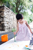 Little girl painting — Stock Photo
