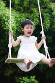 Girl sitting on swing — Stock Photo